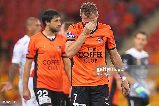 Besart Berisha of the Roar leaves the field after being handed a red card during the round 25 ALeague match between Brisbane Roar and Melbourne Heart...