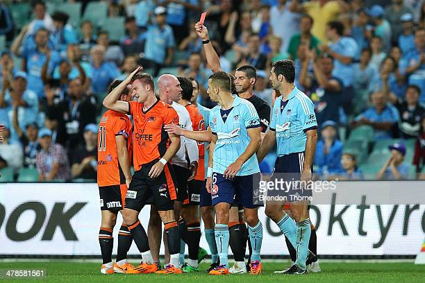 Besart Berisha of the Roar receives a red card from referee Peter O'Leary during the round 23 ALeague match between Sydney FC and Brisbane Roar at...