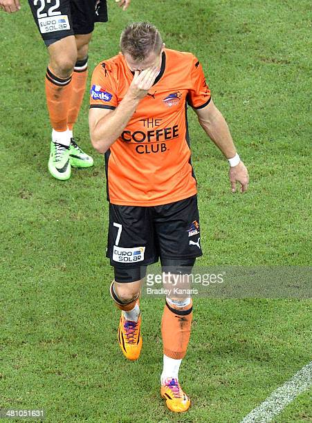 Besart Berisha of the Roar walks from the field distraught after he was given a red card by referee Chris Beath for his challenge on Robbie Wielaert...