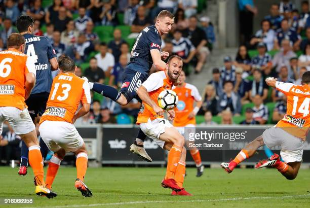 Besart Berisha of the Victory and Ivan Franjic of the Roar compete for the ball during the round 20 ALeague match between the Melbourne Victory and...