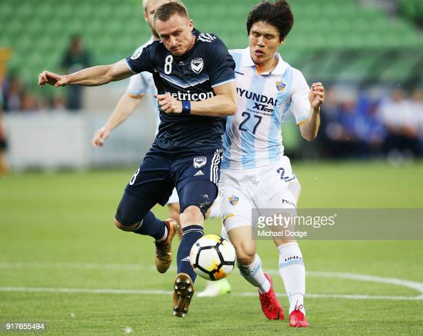 Besart Berisha of the Victory and Kim ChangSoo of Ulsan Hyundai compete for the ball during the AFC Asian Champions League match between the...