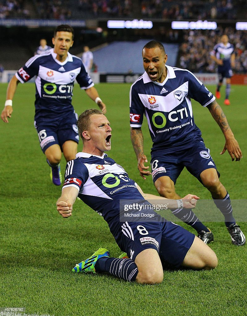Besart Berisha (C) of the Victory celebrates a goal with Archie Thompson (R) during the round three A-League match between the Melbourne Victory and Melbourne City at Etihad Stadium on October 25, 2014 in Melbourne, Australia.