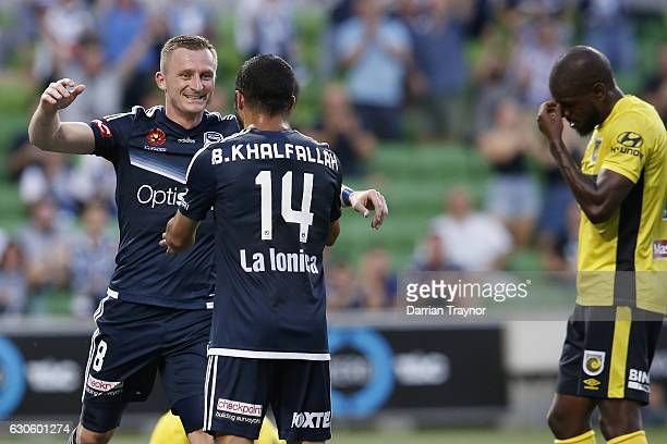 Besart Berisha of the Victory celebrates a goal with team mate Ben Khalfallah during the round 12 ALeague match between Melbourne Victory and Central...