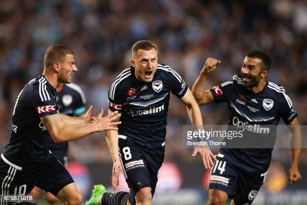 Besart Berisha of the Victory celebrates with team mates after scoring a goal during the 2017 ALeague Grand Final match between Sydney FC and the...