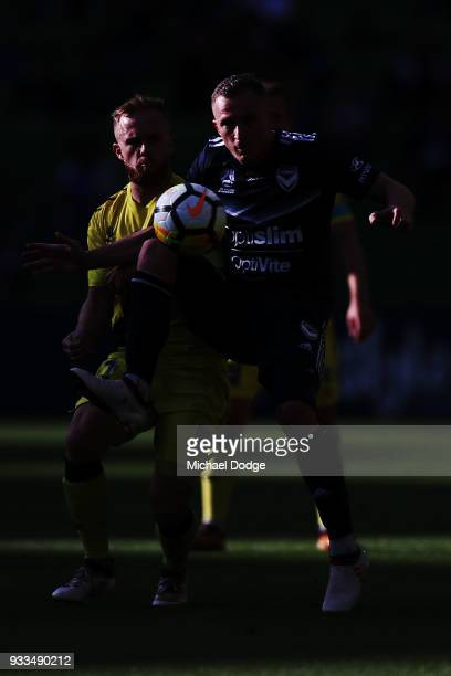 Besart Berisha of the Victory compete for the ball ahead of Connor Pain of the Mariners during the round 23 ALeague match between the Melbourne...