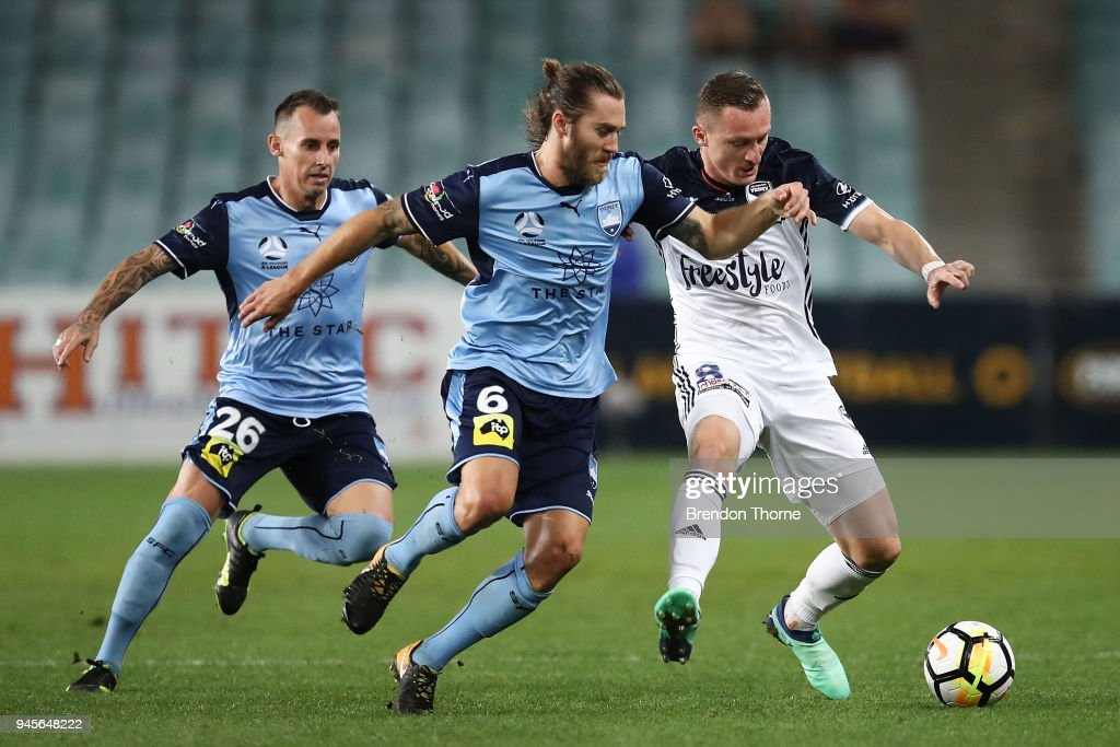 Besart Berisha of the Victory competes with Joshua Brillante of Sydney during the round 27 A-League match between Sydney FC and the Melbourne Victory at Allianz Stadium on April 13, 2018 in Sydney, Australia.
