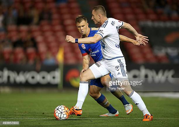 Besart Berisha of the Victory contests the ball with Daniel Mullen of the Jets during the round three A-League match between the Newcastle Jets and...