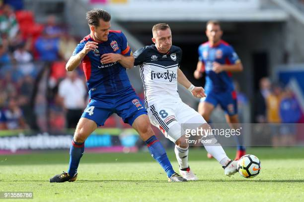 Besart Berisha of the Victory contests the ball with Nigel Boogaard of the Jets during the round 19 ALeague match between the Newcastle Jets and the...