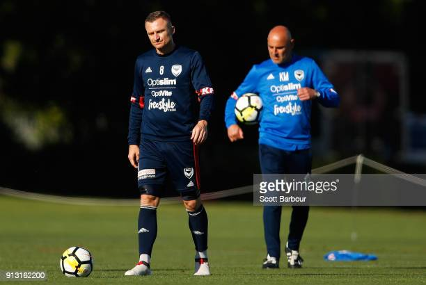 Besart Berisha of the Victory controls the ball as Kevin Muscat coach of the Victory looks on during a Melbourne Victory ALeague training session at...