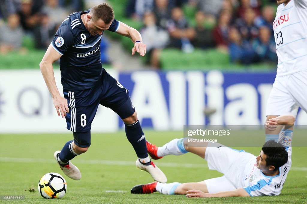Besart Berisha of the Victory fails to get a free kick from this tackle by Shogo Taniguchi of Kawasaki Frontale in the square during the AFC Asian Champions League match between the Melbourne Victory and Kawasaki Frontale at AAMI Park on March 13, 2018 in Melbourne, Australia.