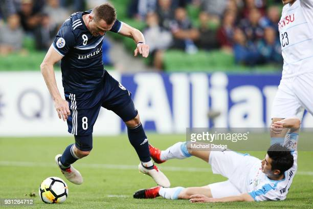 Besart Berisha of the Victory fails to get a free kick from this tackle by Shogo Taniguchi of Kawasaki Frontale in the square during the AFC Asian...