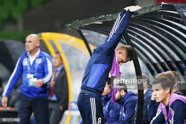 Besart Berisha of the Victory gets frustrated watching from the bench during the AFC Asian Champions League match between the Melbourne Victory and...