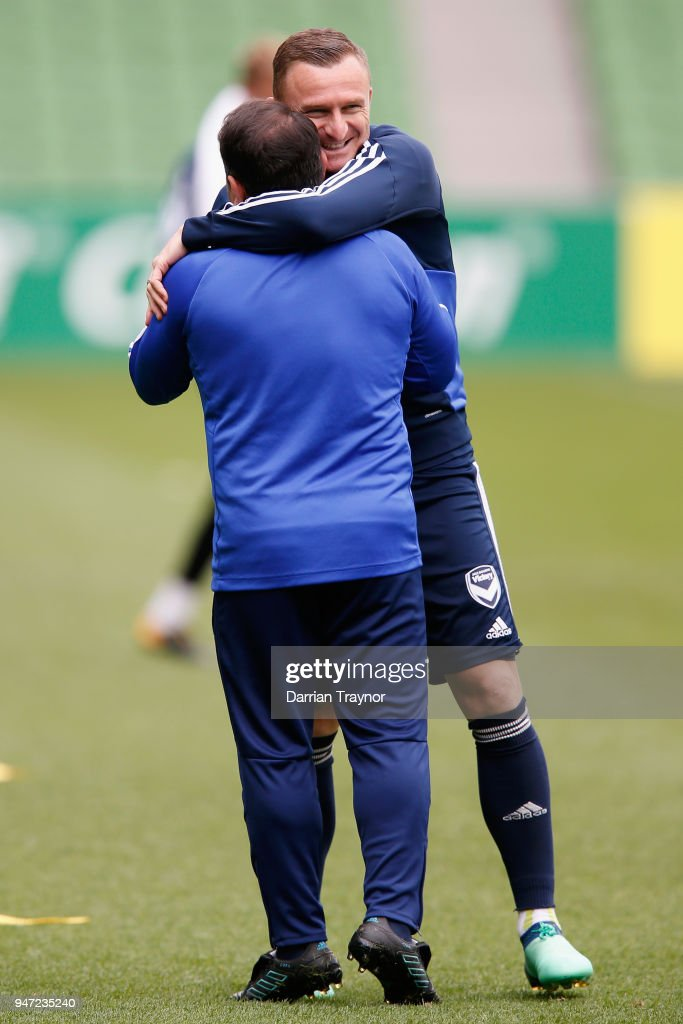 Besart Berisha of the Victory hugs an assistant coach during a Melbourne Victory training session at AAMI Park on April 17, 2018 in Melbourne, Australia.