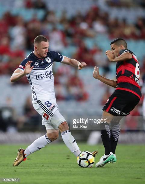 Besart Berisha of the Victory is challenged by Marcelo Carrusca of the Wanderers during the round 17 ALeague match between the Western Sydney...