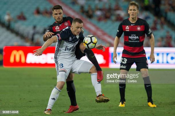 Besart Berisha of the Victory is challenged in this tackle by Wanderers Josh Risdon during the round 17 ALeague match between the Western Sydney...