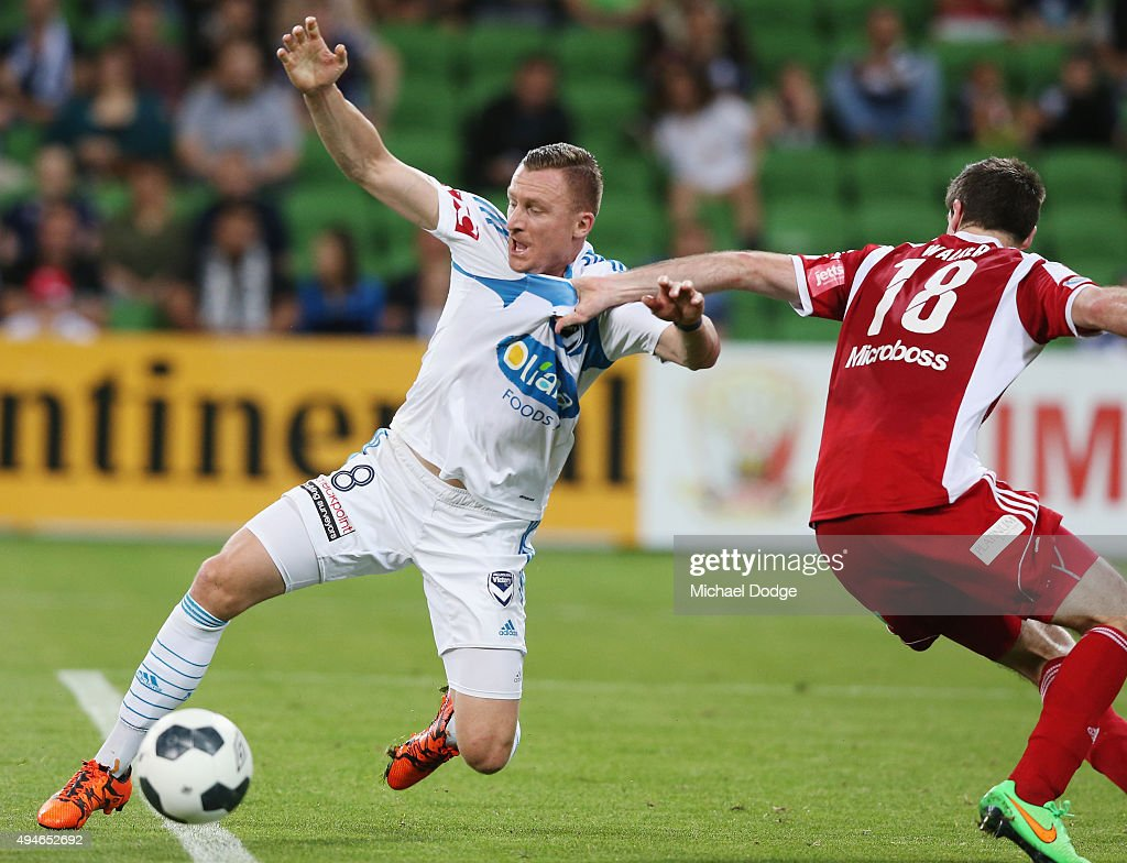 Besart Berisha of the Victory is given a penalty after this contest with Bradley Walker of the City (R) during the FFA Cup Semi Final match between Hume City and Melbourne Victory at AAMI Park on October 28, 2015 in Melbourne, Australia.