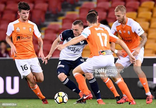 Besart Berisha of the Victory is surrounded by the Roar defence during the round 11 ALeague match between the Brisbane Roar and the Melbourne Victory...