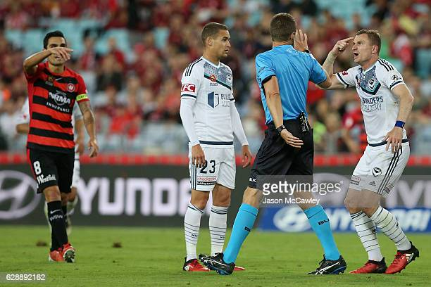 Besart Berisha of the Victory speaks to referee Chris Beath during the round 10 ALeague match between the Western Sydney Wanderers and the Melbourne...