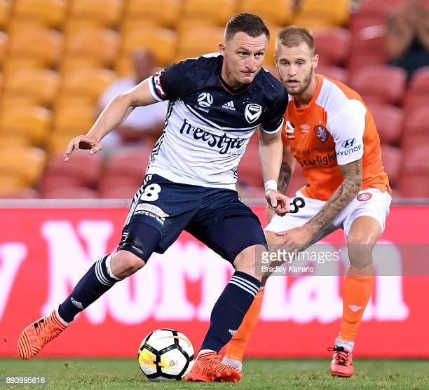 Besart Berisha of the Victory takes on the defence during the round 11 ALeague match between the Brisbane Roar and the Melbourne Victory at Suncorp...