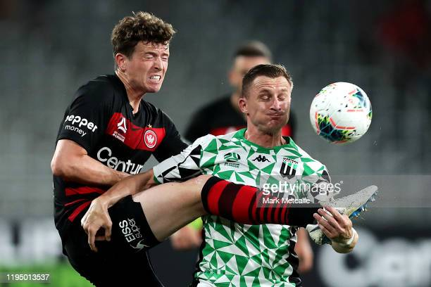 Besart Berisha of United and Patrick Ziegler of the Wanderers compete for the ball during the round 11 W-League match between the Western Sydney...