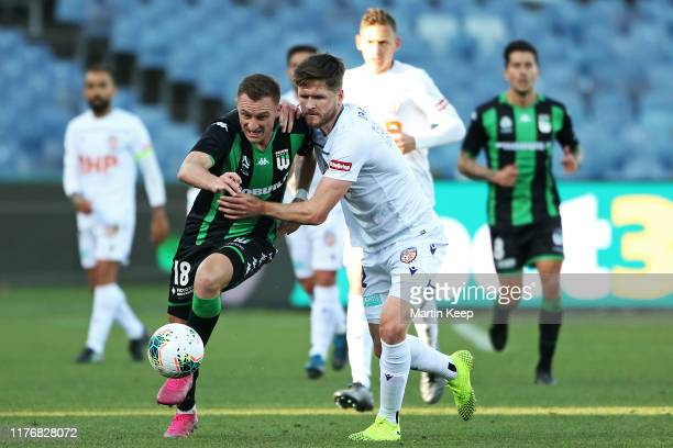 Besart Berisha of Western United competes for the ball with Alex Grant of the Glory during the round two ALeague match between Western United and...