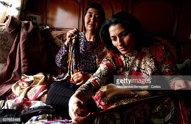 Besic Zubedja and Sejdic Remzija both gipsy tailors from Bosnia Herzegovina sew outfits in their caravan for the first fashion show entirely...