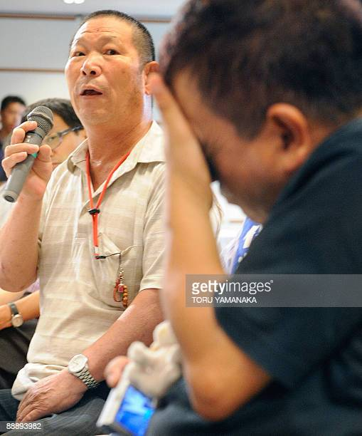 Beside other patients Minamata disease patient Hideo Ikoma criticizes a bill during a press conference in Tokyo on July 8 2009 The Diet passed the...