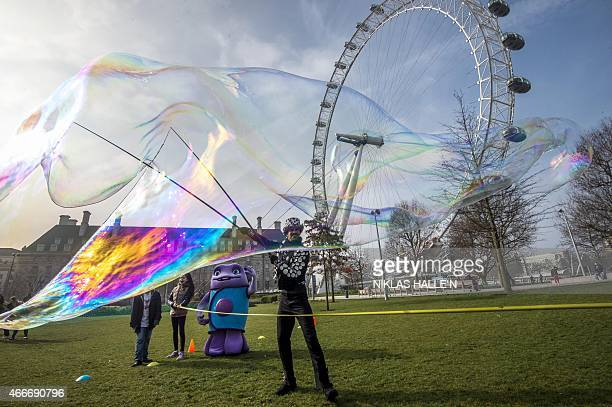 Beside the landmark 'London Eye' Bubbleologist Sam Heath otherwise know as Samsam Bubbleman attempts to break his tenth Guinness World Record by...