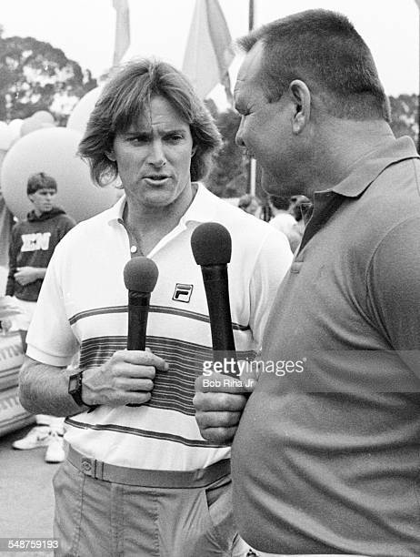 Beside the pool at the University California Santa Barbara American former professional athletes Bruce Jenner and Dick Butkus host a swimming event...