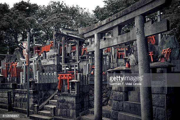 Besides the usual torii gates that are so popular in Fushimi Inari shrine Kyoto one can also find many small shrines with stacks of miniature torii...