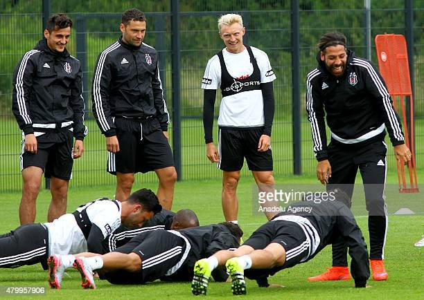 Besiktas' Andreas Beck , Dusko Tosic , Olcay Sahan and Mustafa Pektemek are seen during a training session during their camp in Mairenfeld village in...