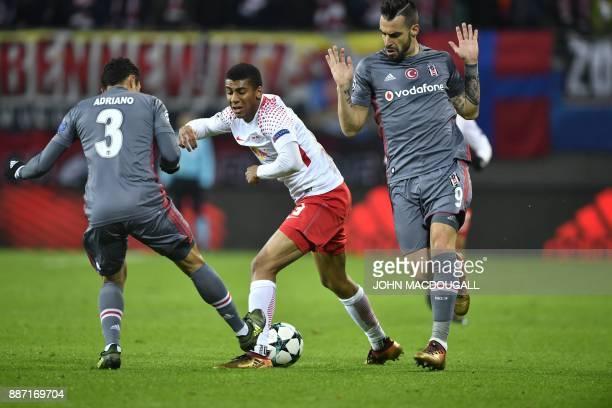 Besiktas' Brazilian defender Adriano Correia Leipzig's Brazilian defender Bernardo and Besiktas' Spanish forward Alvaro Negredo vie for the ball...