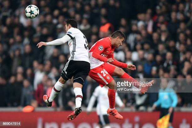Besiktas' Brazilian defender Adriano Correia vies with Monaco's Portuguese midfielder Rony Lopes during the UEFA Champions League Group G football...