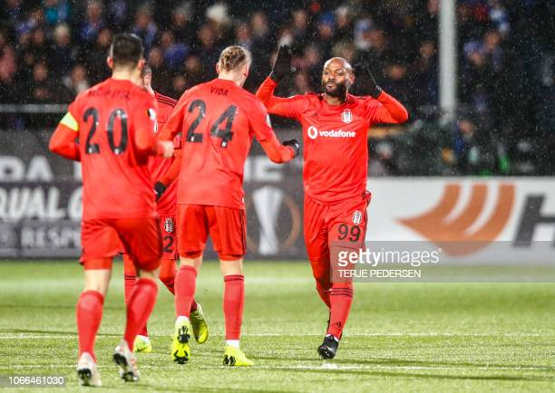 Besiktas' Brazilian forward Vagner Love celebrates with teammates after scoring during the UEFA Europa League group I football match Sarpsborg v...