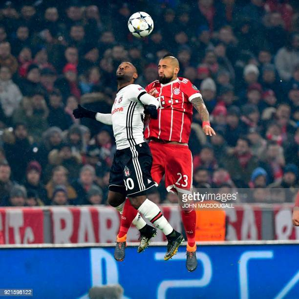 Besiktas' Brazilian forward Wagner Love and Bayern Munich's Chilean midfielder Arturo Vidal vie with the ball during the UEFA Champions League round...
