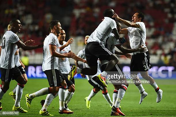 Besiktas' Brazilian midfielder Anderson Talisca celebrates a goal with teammates during the UEFA Champions League football match SL Benfica vs...