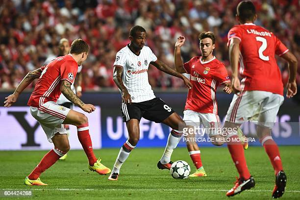Besiktas' Brazilian midfielder Anderson Talisca vies with Benfica's midfielder Andre Horta during the UEFA Champions League football match SL Benfica...