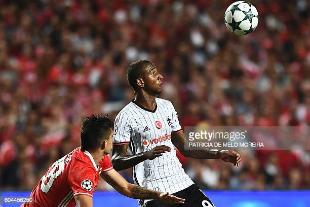 Besiktas' Brazilian midfielder Anderson Talisca vies with Benfica's Colombian midfielder Guillermo Celis during the UEFA Champions League football...