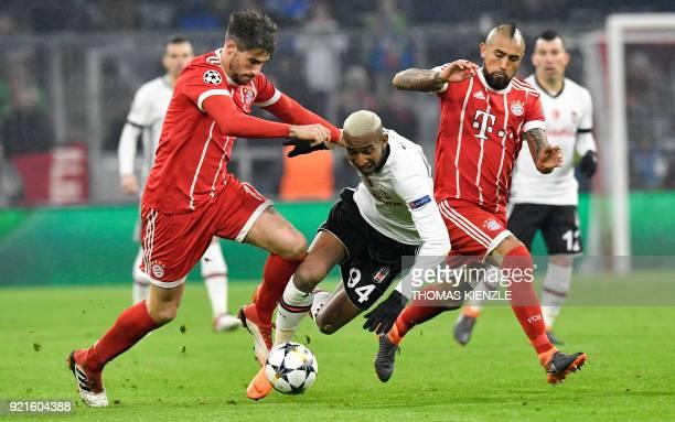 Besiktas' Brazilian midfielder Talisca fights for the ball with Bayern Munich's Chilean midfielder Arturo Vidal and Bayern Munich's Spanish...