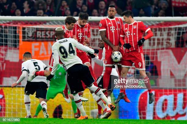 Besiktas' Brazilian midfielder Talisca shoots a free quick during the UEFA Champions League round of sixteen first leg football match Bayern Munich...