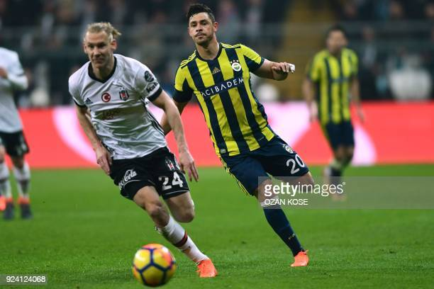 Besiktas' Croatian defender Domagoj Vida vies for the ball with Fenerbahce's Brazilian midfielder Guiliano during the Turkish Super Lig football...