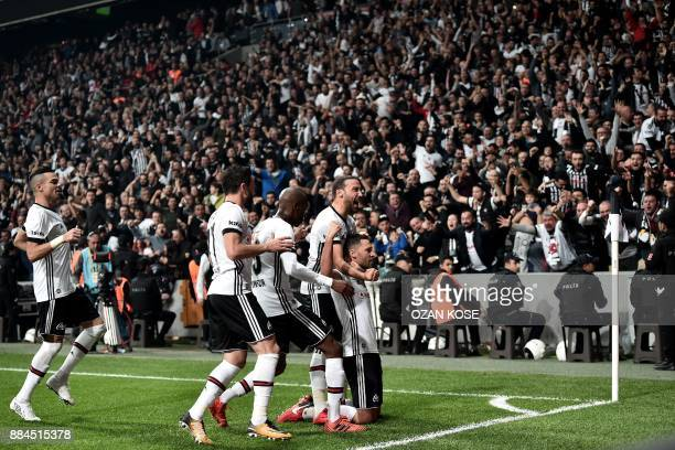 Besiktas' defender Dusko Tosic celebrates with his teammates after scoring a goal during the Turkish Super Lig football match between Besiktas and...