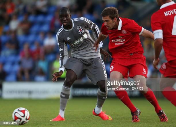 Besiktas' Demba Ba and FSV Mainz 05's Sefan Bell in action