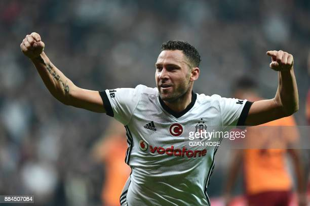Besiktas' Dusko Tosic celebrates after scoring a goal during the Turkish Super Lig football match between Besiktas and Galatasaray on December 2,...