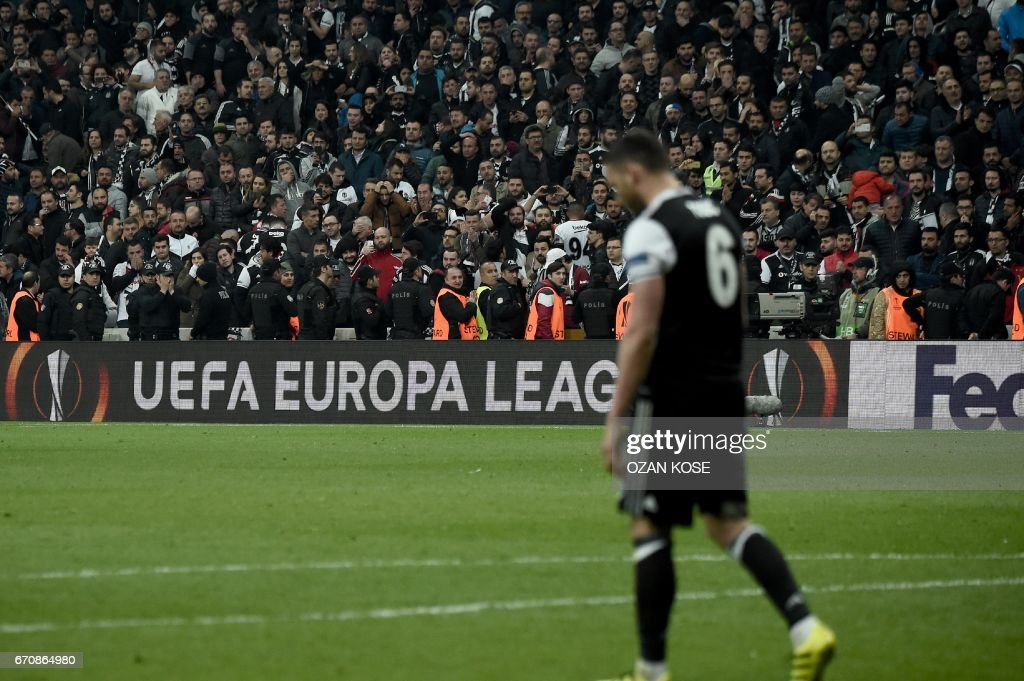 Besiktas' Dusko Tosic reacts after missing a penalty at the end of the UEFA Europa League second leg quarter final football match between Besiktas and Lyon (OL) on April 20, 2017, near the Vodafone arena stadium in Istanbul. /