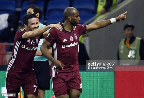 Besiktas' Dutch midfielder Ryan Babel is congratuled by Besiktas' Turkish defender Gokhan Gonul after scoring a goal during the UEFA Europa League...