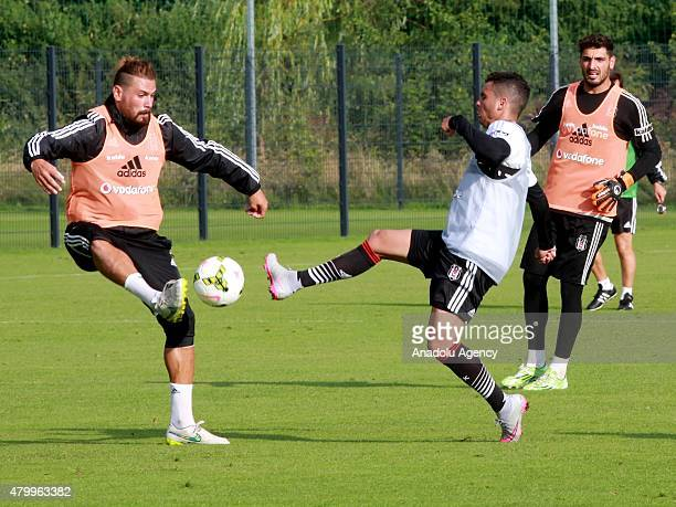 Besiktas' Ersan Gulum and Pedro Franco in action during a training session during their camp in Mairenfeld village in Harsewinkel city, Germany on...
