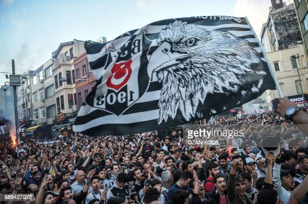 Besiktas' fans celebrate their 20162017 champion title in the Besiktas district in Istanbul during celebrations after their team won the Turkish...