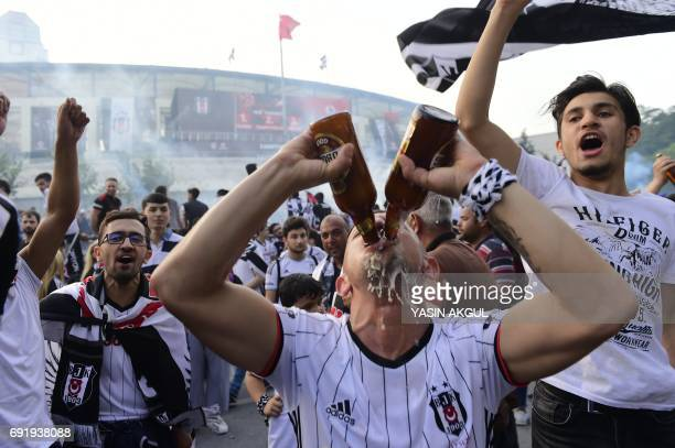 Besiktas' fans celebrate their 20162017 Turkish league champion title after the Turkish Spor Toto Super league football match between Besiktas and...