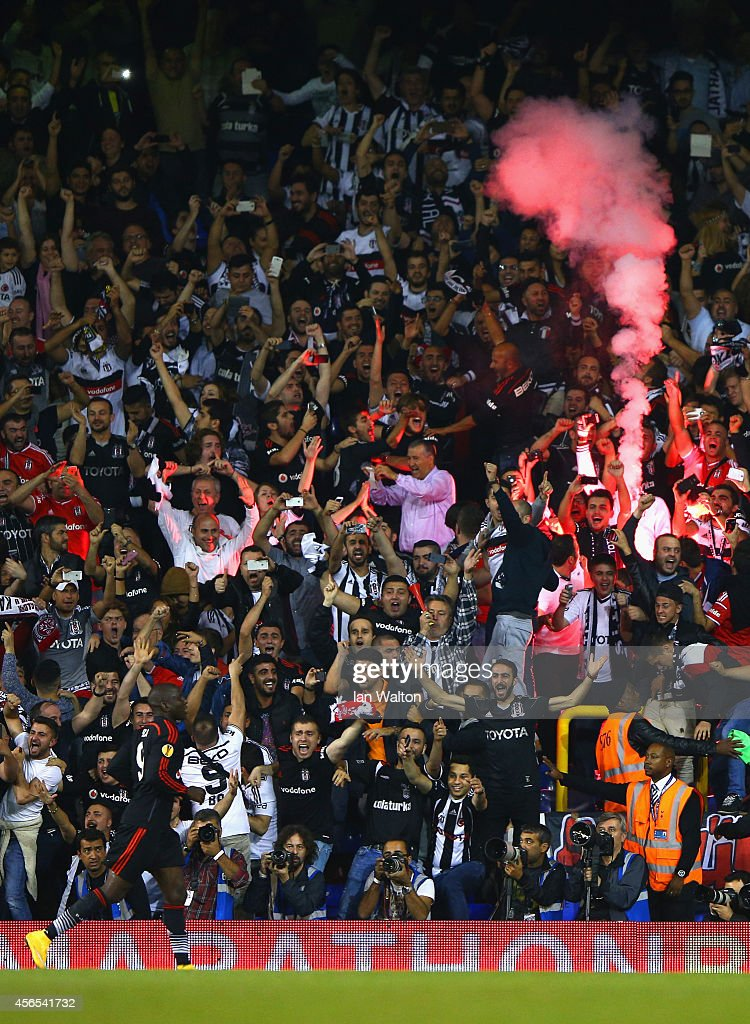 Besiktas fans light a flare as Demba Ba of Besiktas celebrates scoring the equalising goal during the UEFA Europa League Group C match between Tottenham Hotspur FC and Besiktas JK at White Hart Lane on October 2, 2014 in London, United Kingdom.